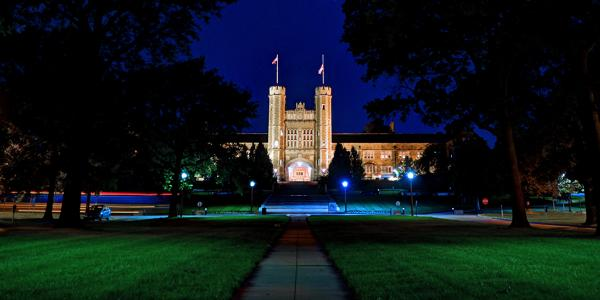 Brookings Hall lit up at night time