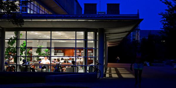 Students studying in Olin Library on Washington University's Danforth campus at night