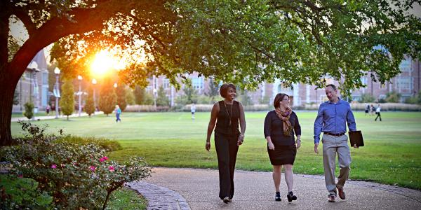 University College students walking on Danforth Campus in the evening