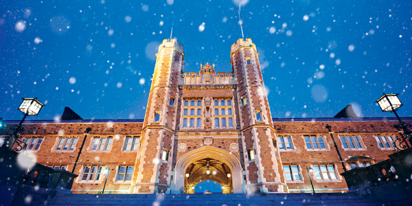 Brookings Hall at night with snow.
