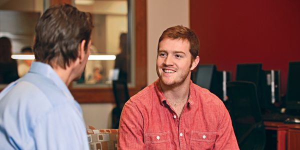 student speaking with an advisor